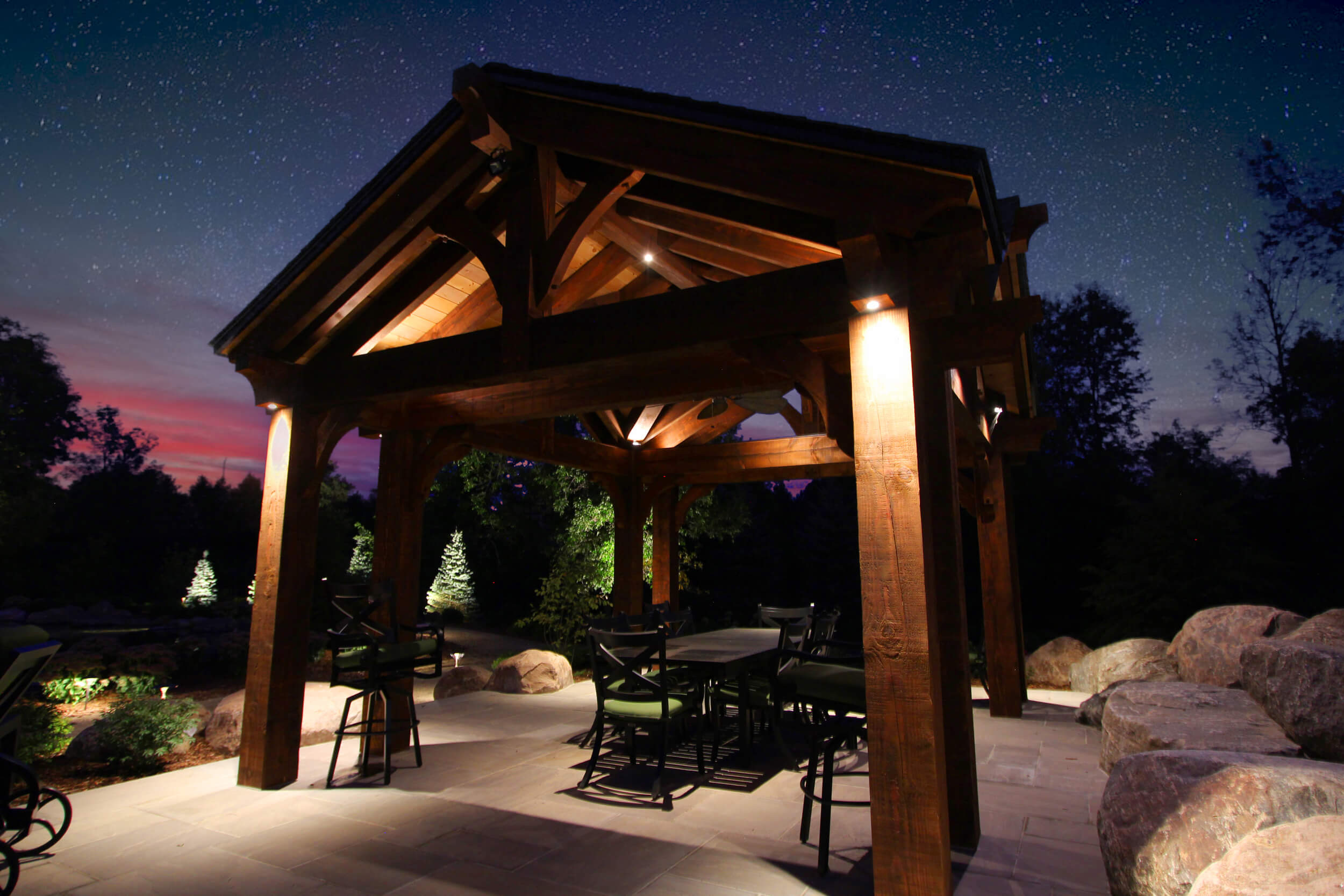 Puslinch timber frame with copper downlighting